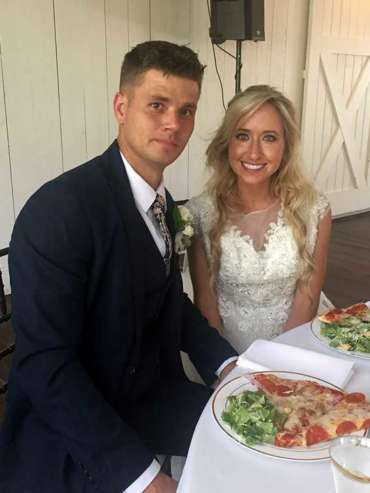 Bride and groom enjoying pizza!